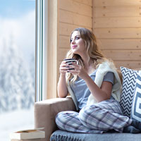 Enjoying a cup of coffee in the winter